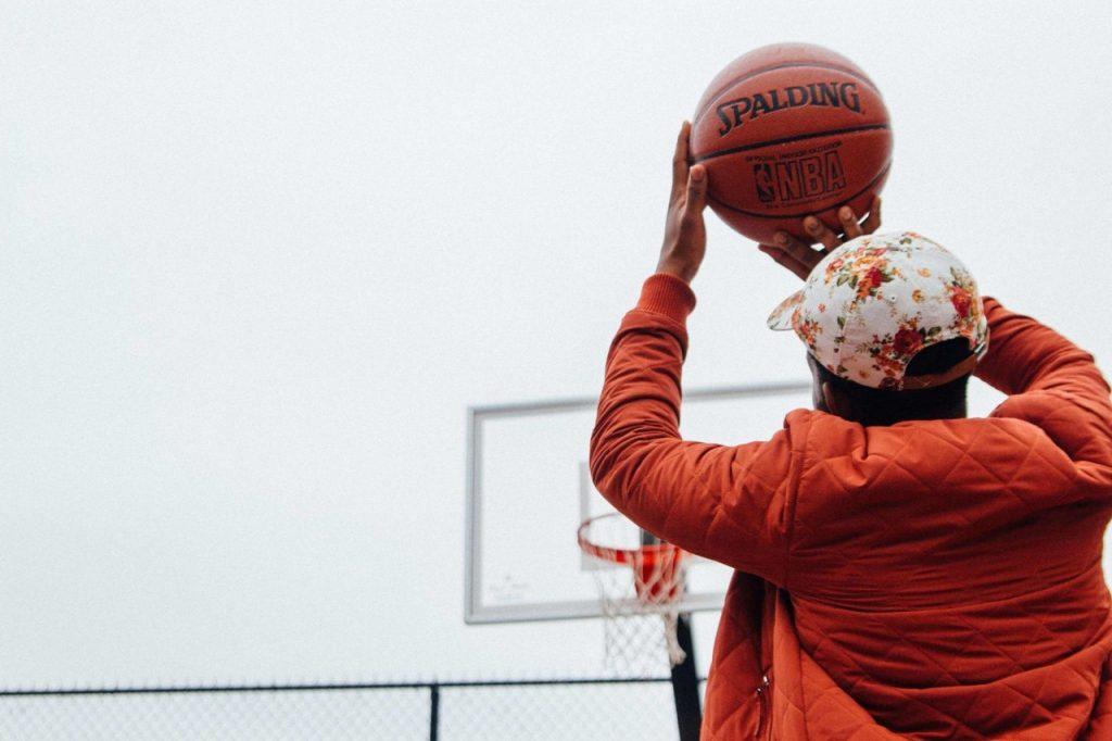 person shooting basketball